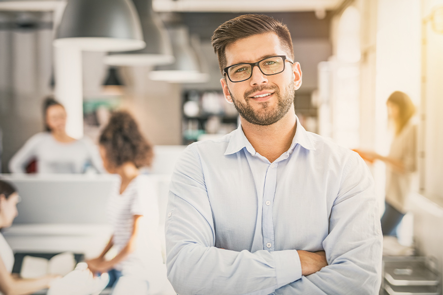 Business Insurance - Portrait of Man Standing in Front of His New Startup Business